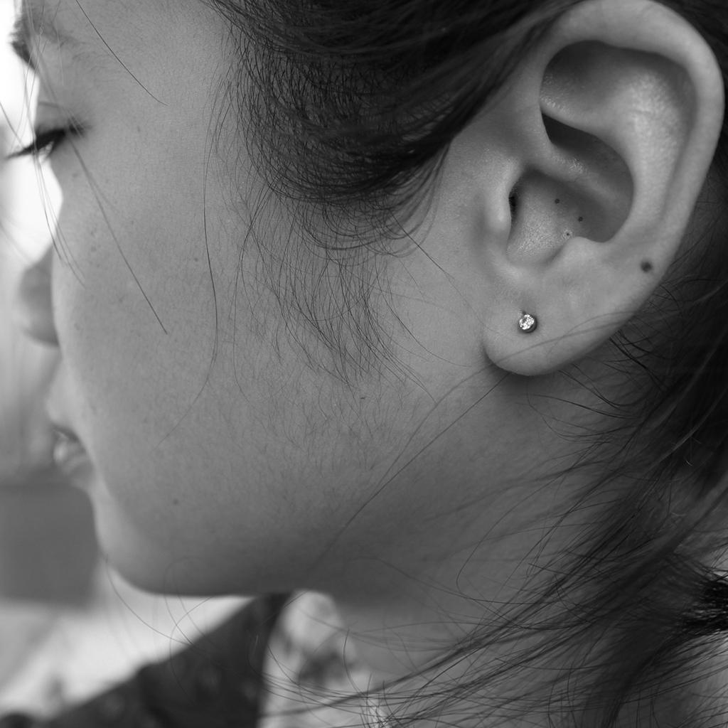 Piercing a baby girl's ear